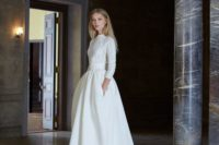 09 a white cable knit sweater with long sleeves over an A-line wedding gown