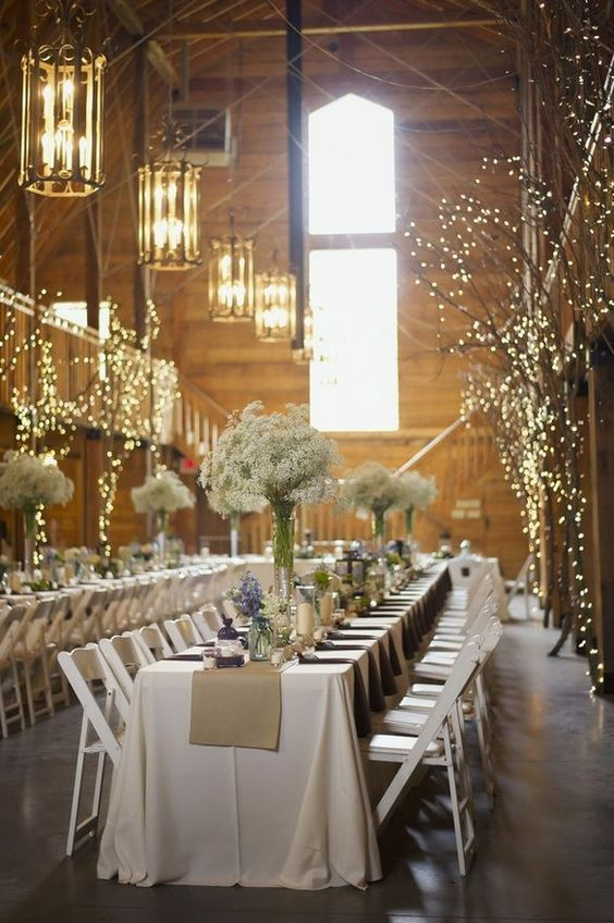 place some large branches or tree parts in your venue lights to make the space unique