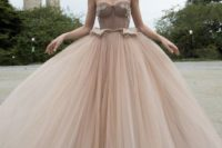 09 strapless corset princess wedding dress with a full layered skirt for modern princesses who want to stand out