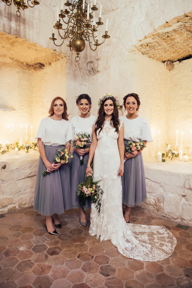 The bridesmaids were wearing dove grey tulle skirts and white tops