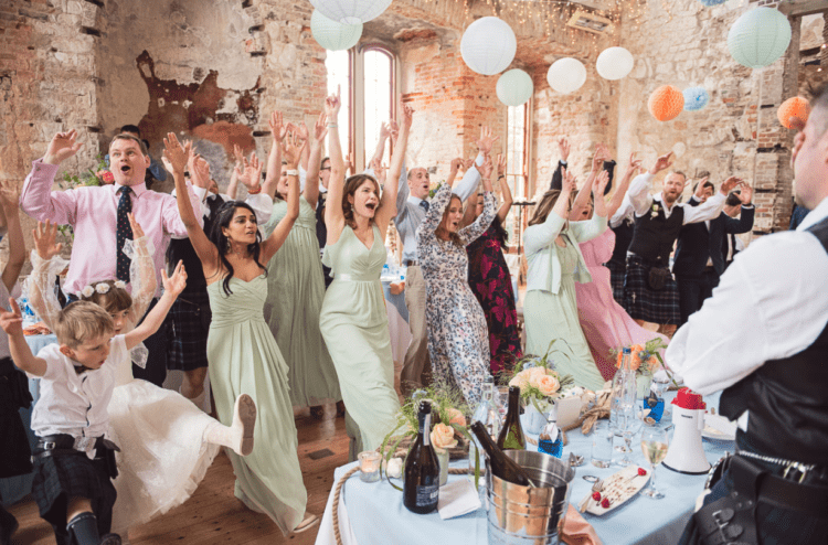 The bridesmaids were wearing mismatching mint-colored dresses