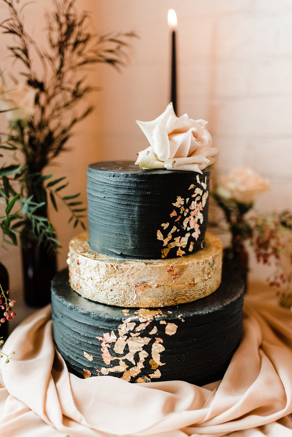 The wedding cake was a textural black and gold one with gold leaf decor and a blush bloom on top