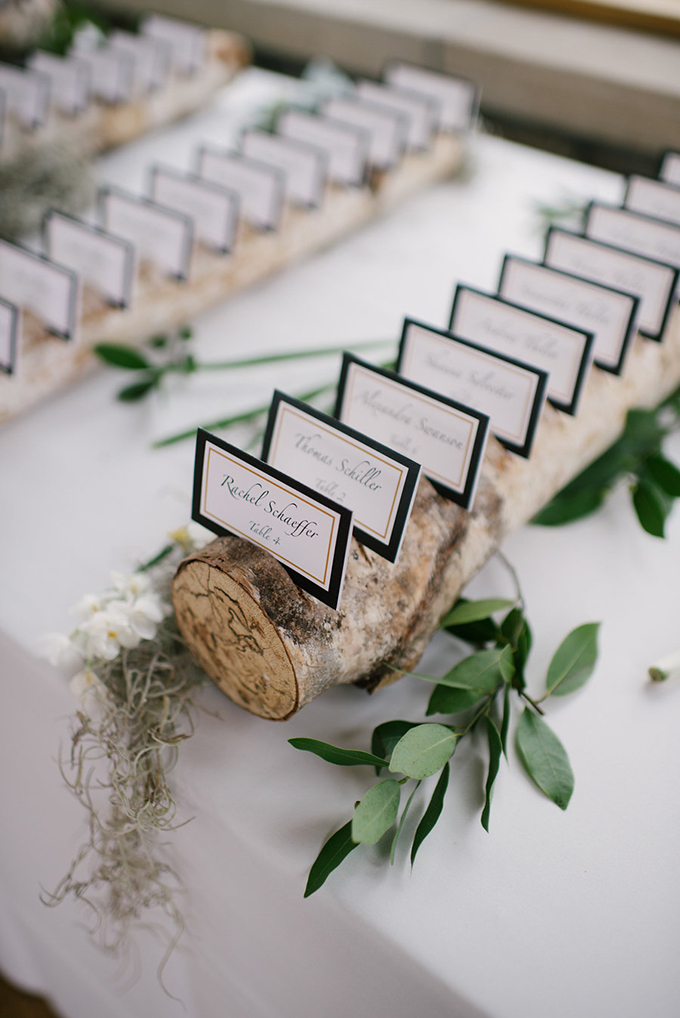 The wedding escort cards were done in black and white and placed on branches