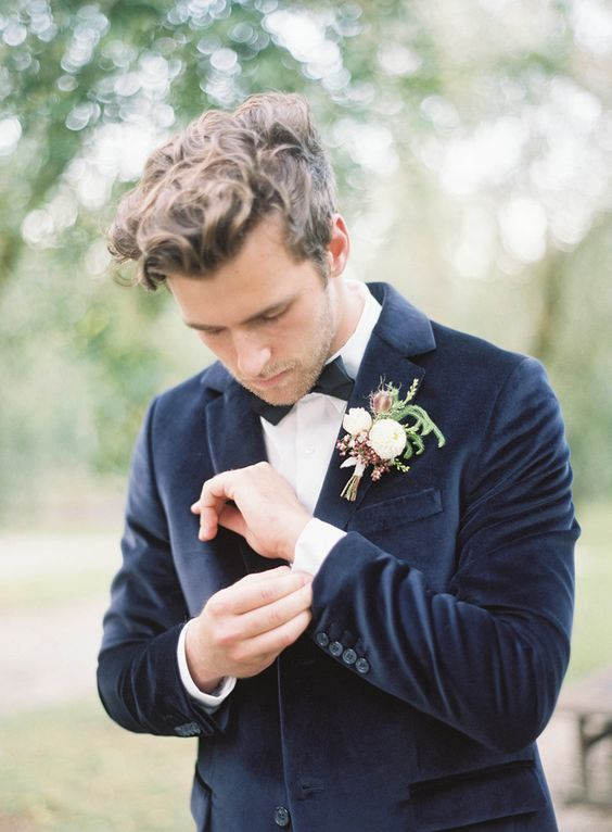 a classic tuxedo look with a velvet jacket is a fresh take on timeless groom's attire