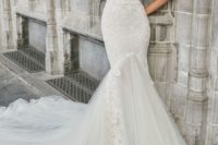 10 a creamy strapless corset wedding dress with lace appliques and a tulle tail with a train looks wow