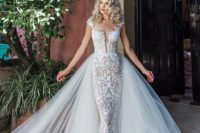 10 a textural lace sheath wedding dress with a plunging neckline, cap sleeves and a layered tulle skirt