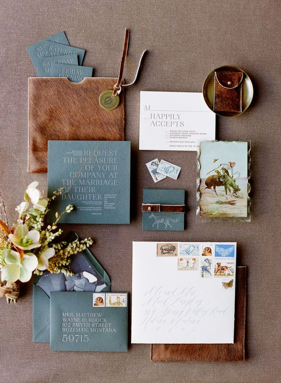 a wedding invitation suite with slate blue and brown leather touches is very bold and chic