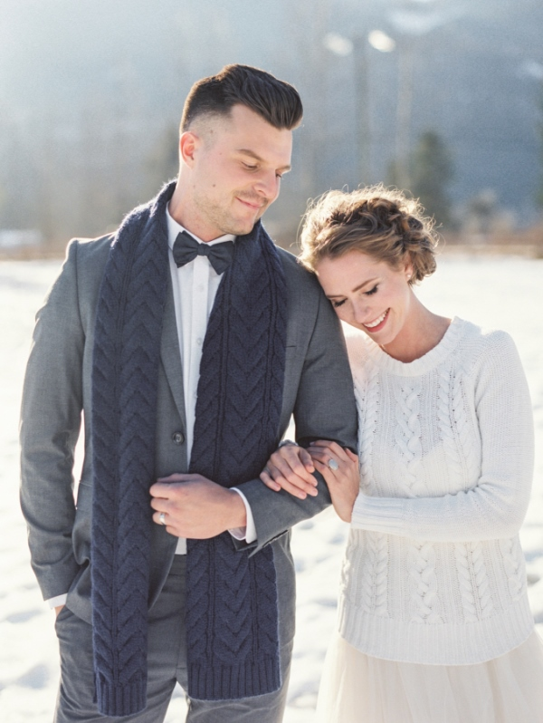 a white cable knit sweater over the neutral wedding dress for outdoor shots