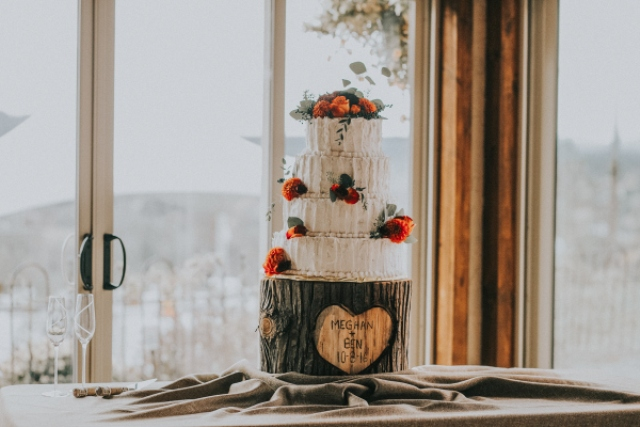 The wedding cake was a textural one with orange blooms and greenery