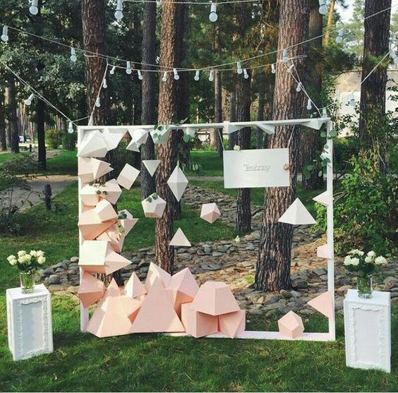 a dimensional geometric figure backdrop is a unique solution to try