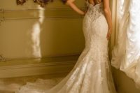 11 a gorgeous lace wedding dress with a train and shoulder jewelry