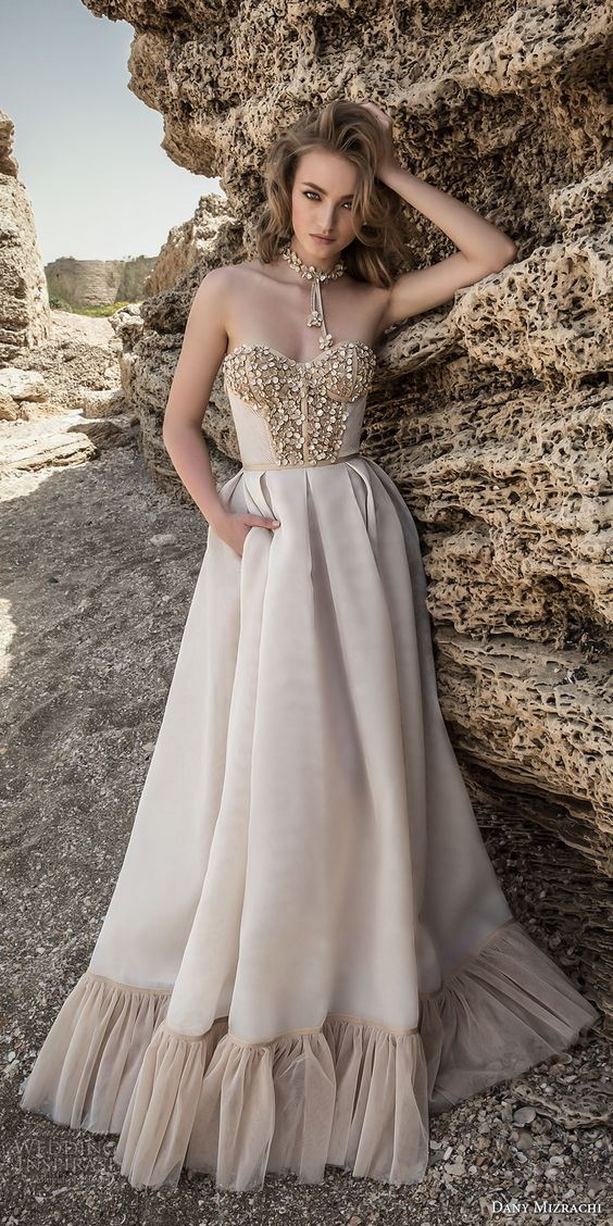 strapless sweetheart neckline wedding dress with an embellished bodice and skirt detailing
