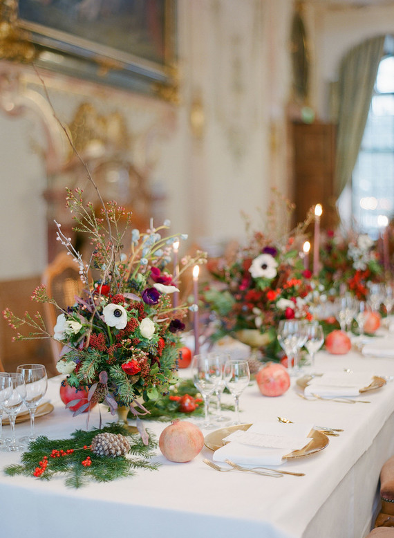 The tablescape was done with pinecones, pomegranates, evergreens, berries and colored candles and had a strong holiday feel
