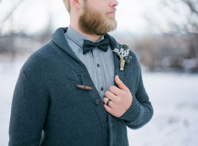 a dark grey cardigan, a grey shirt and a black bow tie for a relaxed winter groom look