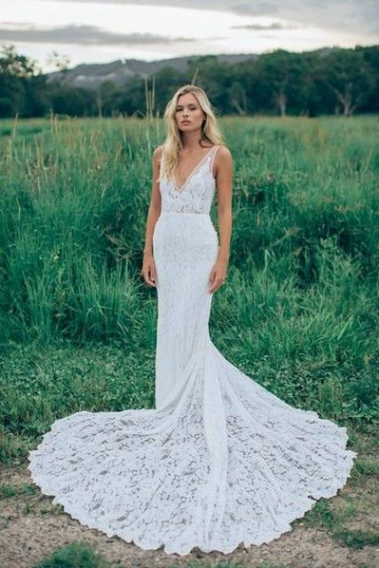 a lace mermaid wedding dress with a semi sheer bodice and a deep cut for a gorgeous tropical bridal look