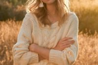12 a neutral skirt and a neutral cable knit slouchy sweater with long sleeves and a crocheted beanie
