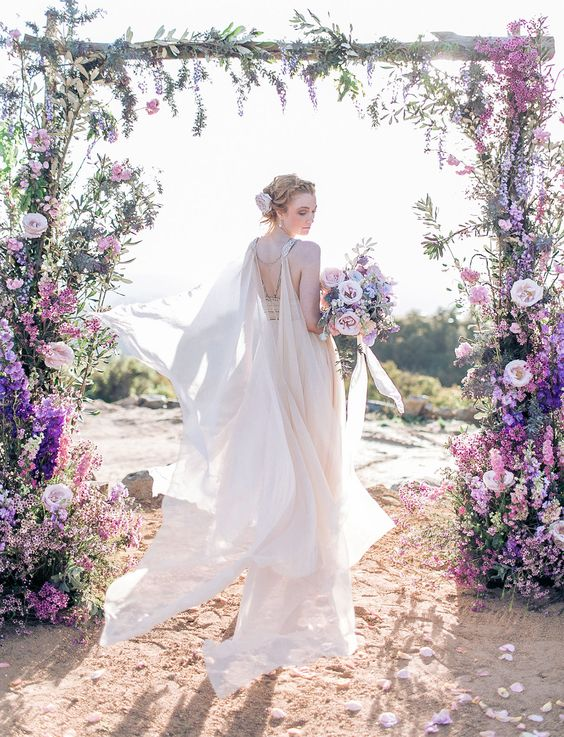 a chic wedding floral arch in the shades of purple looks so very natural as if flowers are growing themselves like that