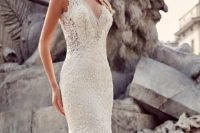 13 a mermaid lace applique strap wedding dress with a deep V neckline and embellishments
