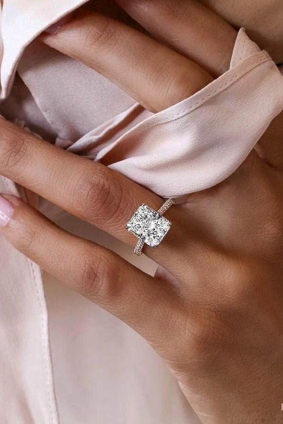 a white gold band engagement ring with a rectangular diamond is a stylish modern idea