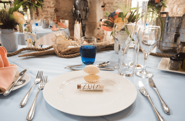 The tables were styled in the sea theme with rope, with shells, messages-in-a-bottle and candles