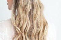 14 a braided half updo with waves looks very boho-like