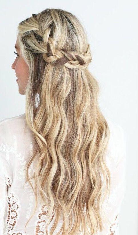a braided half updo with waves looks very boho like