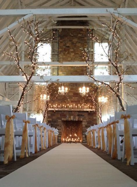whole trees with lights put in the ceremony space, candles in the fireplace and on the mantel