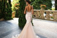 15 an open back mermaid wedding gown in blush with white lace appliques