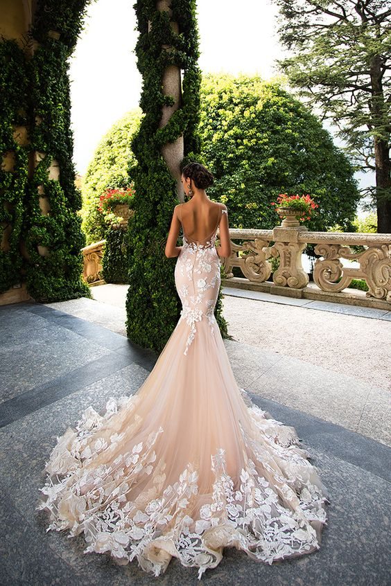 Picture Of an open back mermaid wedding gown in blush with white ...