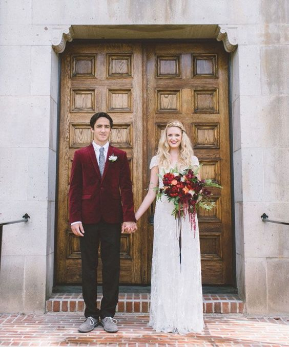 grey shoes and a burgundy velvet jacket add a fall touch to the groom's look