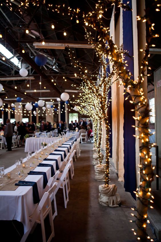 potted trees wrapped with lights look fantastic and will make your venue magical