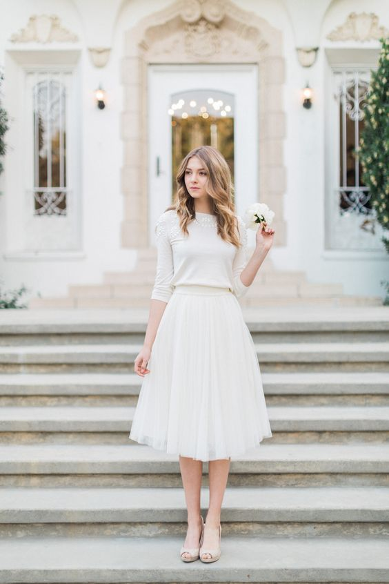 a city hall outfit with a neutral embellished sweater, a tulle knee skirt and nude peep toe shoes