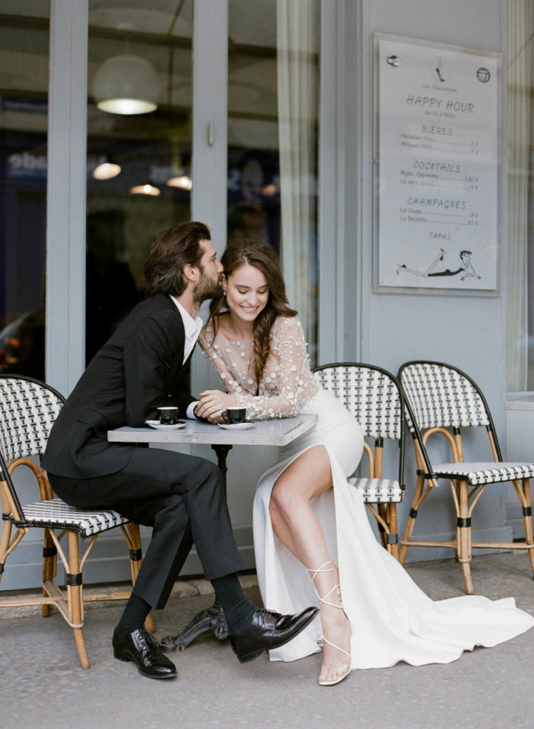 a glam wedding gown with a lace applique illusion bodice, a plain skirt with a slit and long sleeves
