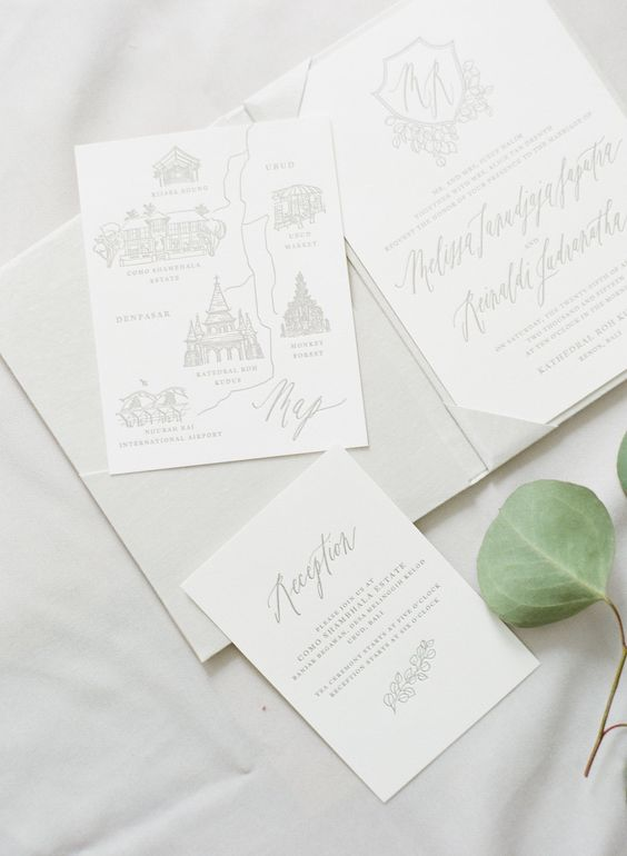 a reception card and a Bali map for a destination wedding