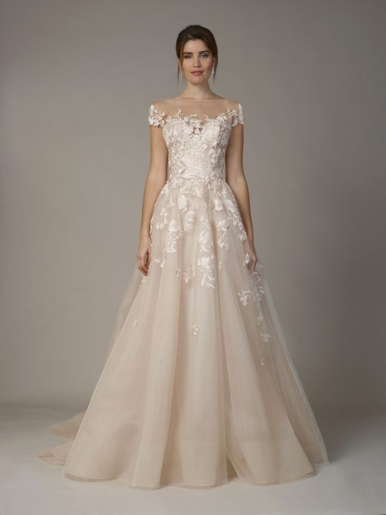a romantic off the shoulder wedding gown with white lace appliques and cap sleeves