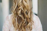 16 a twisted and wavy half updo is one of the hottest trends currently
