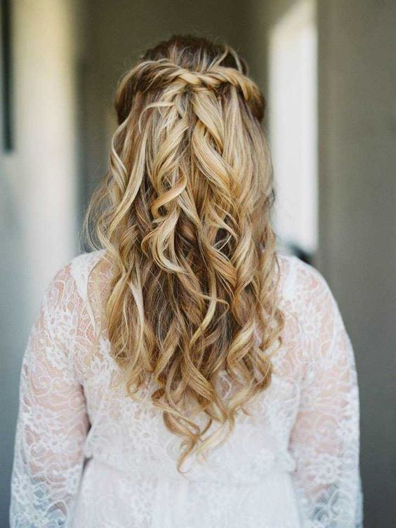 a twisted and wavy half updo is one of the hottest trends currently
