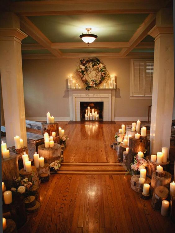 if it's a rustic wedding, why not place candles on wood stumps and wood slices to stick to the style