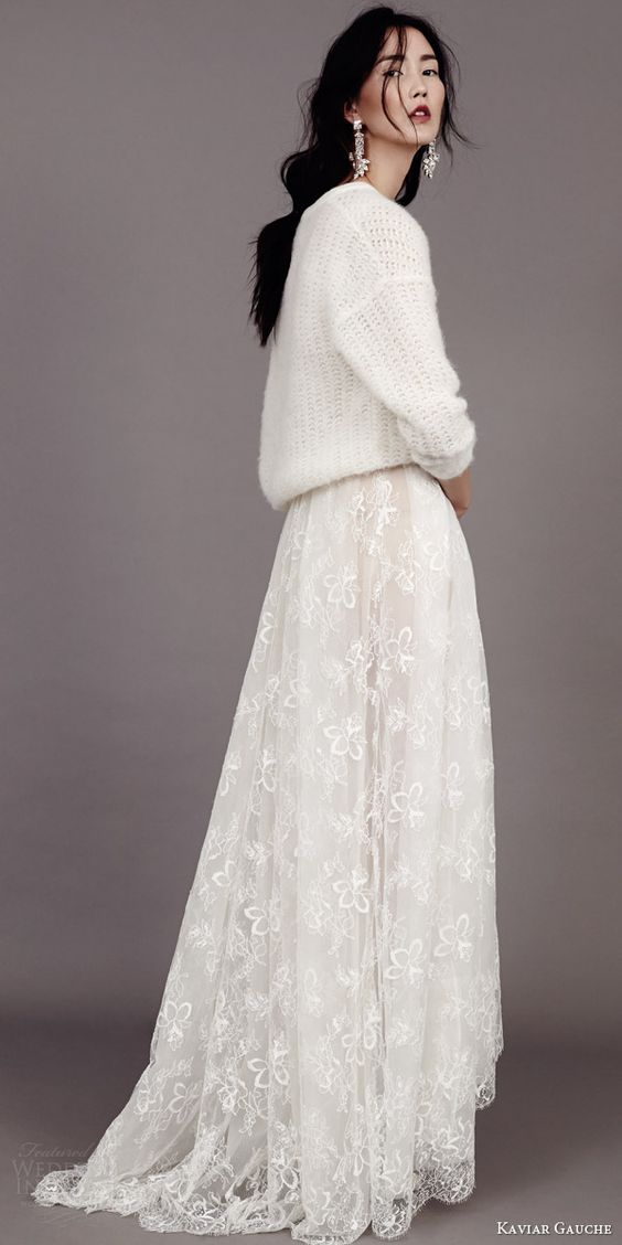 a chunky knit white sweater, a white lace maxi skirt, a messy hairstyle and statement earrings for an effortlessly chic look