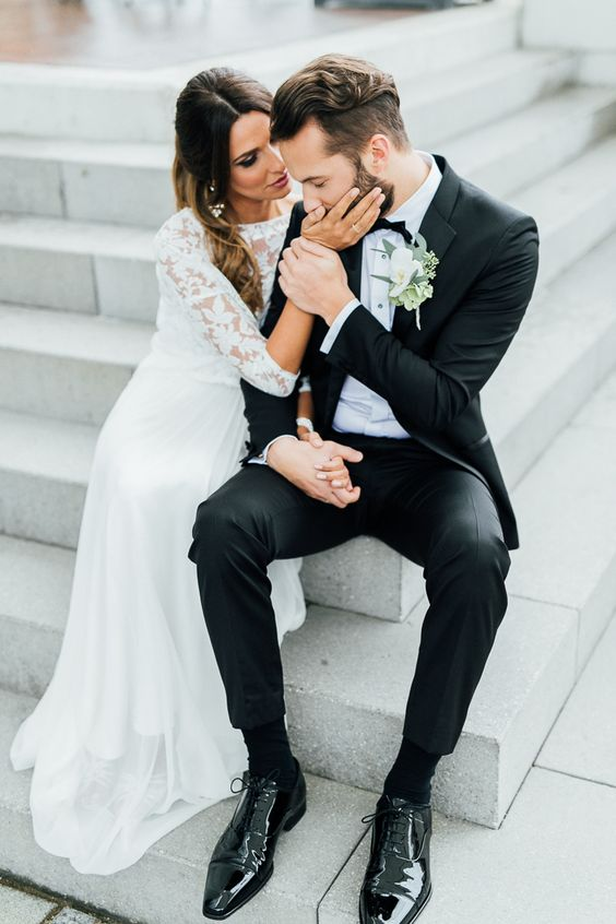 a romantic wedding gown with a high neckline long sleeve bodice and a flowy skirt for an elegant bridal look