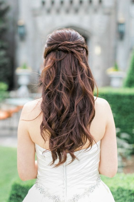 a twisted and wavy half updo will fit many bridal looks, from boho to rustic