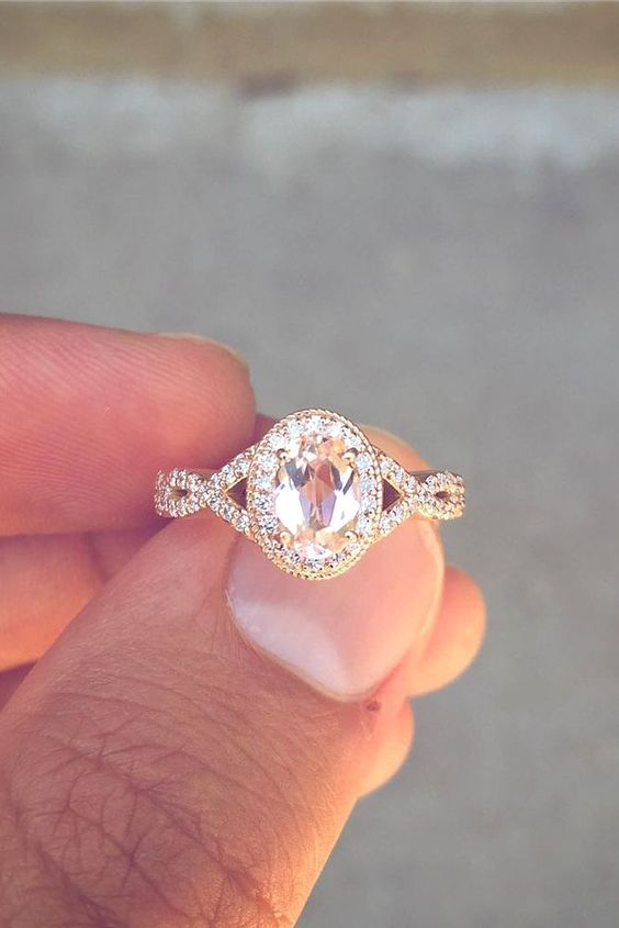 a vintage inspired oval engagement ring of rose gold with a colored diamond looks wow