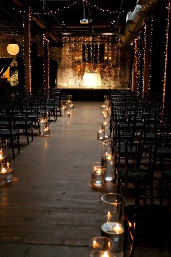 make your ceremony space amazing just hanging lots of lights and wrapping the pillars with them