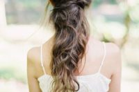 18 a twisted and wavy messy half updo for an effortlessly chic and casual bridal look