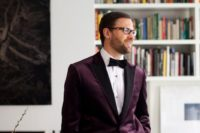 18 black trousers, a white shirt, a deep purple velvet jacket and a black bow tie create a very refined look