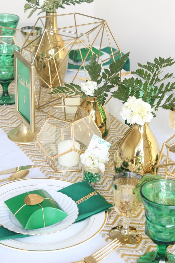 emerald glasses, napkins, table numbers and gold vases, chevron table runners and candle holders for a bold look