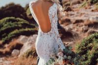 19 a backless lace applique wedding dress with long sleeves and a small train is very sexy and chic