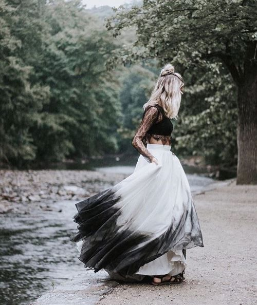 a trendy bridal separate with a sheer black lace crop top and an ombre full skirt from white to black