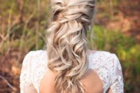 19 a twisted half up half down hairstyle with waves looks very romantic and beautiful