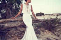 20 a plain modern mermaid wedding dress with an illusion plunging neckline covered with lace, no sleeves